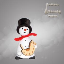 Hennig Figuren - Schneemann mit Schaukelpferd